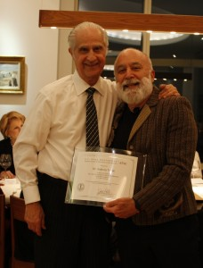 Dr. Jack Dillenberg honors Tony Volpe at his 80th birthday party.