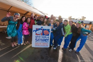 Volunteers pose at the annual ASDOH Give Kids a Smile event in Mesa, Arizona.