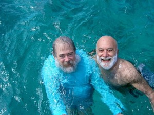 Dr. Jack Dillenberg and Dr. George Rosenberg take a swim in the sea.