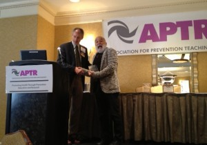 On behalf of ASDOH, Dr. Jack Dillenberg receives the Public Health Educator Program of the Year award from APTR.
