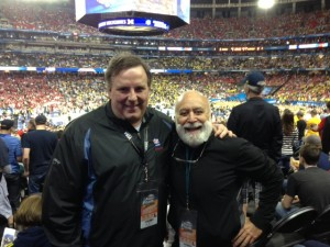 Jeff Parker and Dr. Jack Dillenberg enjoy time together at the NCAA championship basketball game.