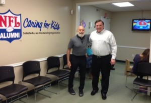 Dr. Jack Dillenberg visits CEO, Jeff Parker, at the Sarrell Clinic.