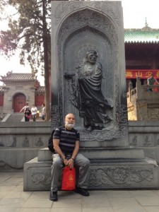 Dr. Jack Dillenberg stands in front of the Shaolin Temple where Kung Fu originated.