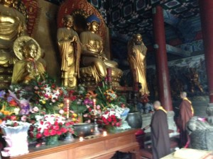 Monks pray at the temple.