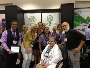 Dr. Tony Hashemian and Dr. Jack Dillenberg meet with hygienists at the Text 2 Floss booth at the Dream Center in Boston.