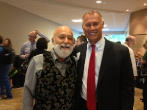 Dr. Jack Dillenberg celebrates with Dr. Rick Workman during the opening of the new health center.