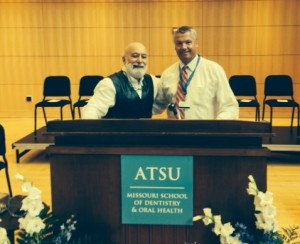 Dean Jack Dillenberg and Dean Chris Halliday celebrate MOSDOH's inaugural White Coat Ceremony.