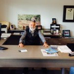 Dr. Jack Dillenberg sits at the desk of PDS's CEO, Steve Thorne.