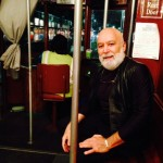 Dr. Jack Dillenberg rides a streetcar in New Orleans.