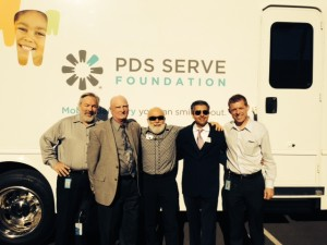 Dr. Jack Dillenberg, Dr. Tony Hashemian and Dr. Ted Wendel join PDS leaders in front of their dental van.