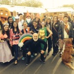 Dr. Jack Dillenberg is with students in costumes for Give Kids a Smile Day.