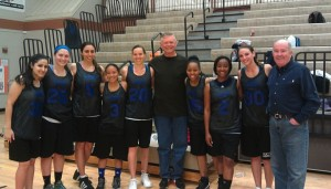 Coach Dr. Scott Morrison and Dr. Jim Bell celebrate with the ASDOH women's basketball team.