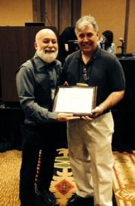 Dr. Robert Sherman gives Dr. Jack Dillenberg a certificate of appreciation for his presentation.