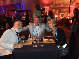 Dr. Jack Dillenberg celebrates PDS's 20th Anniversary party with Dan Perkins and Jamalee Moret.