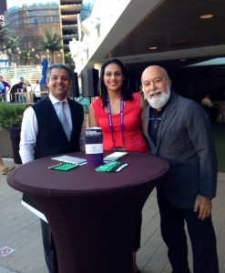 Dr. Jack Dilenberg, Dr. Tony Hashemian and Azra Baab stand by their Text2Floss table.