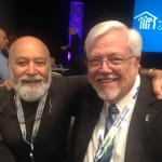 Dr. Jack Dillenberg and Dr. Randy Danielson visit at the NACHC-CHI meeting.
