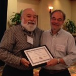 Dr. Jack Dillenberg presents outstanding periodontal faculty award to Dr. Marc Shlossman at the Advance.