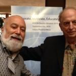 Dr. Jack Dillenberg greets faculty member Morrie Reisbick.