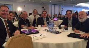 Dr. Jack working with other deans at the Dean's Meeting.