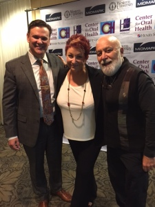 Dr. Jack with Kathy Titus with Henry Schein and Dr. Conrado Barzarga at the symposium.