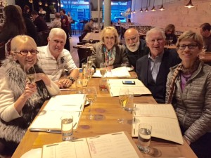 Dr. Jack Dillenberg visits with Dean Linda Niessen, Professor Chet Douglass and their spouses at dinner.