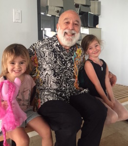 Dr. Jack Dillenberg enjoys time with his granddaughters.