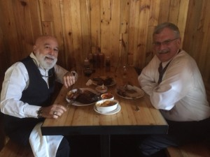 Dr. Jack Dillenberg and Dean Aksu enjoy barbecue at Detroit's iconic SLOW's restaurant.