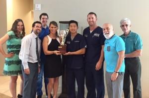 "Smart Practice representatives present the inaugural ""Smart Scrambled"" tournament award to ASDOH."