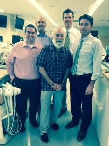 Dr. Jack tours ASDOH facilities with local dental management executives.