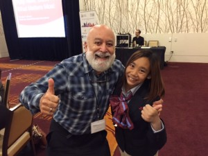 Dr. Jack and Selena, Special Olympics gold medalist from Macau, give a thumbs up at the event.