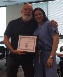 Dr. Jack presents periodontal faculty service award to Tannaz Malekzadeh.