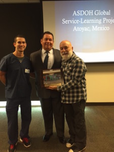 Dr. Jack receives appreciation certificate for ASDOH's participation in Atoyac, Mexico service outreach trip.