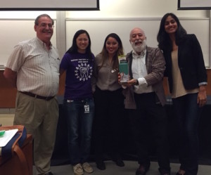 The student leaders present Dr. Jack with a gift to commemorate his 12th year of presenting to their group.