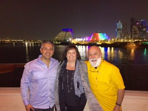 Drs. Maureen Perry, Tony Hashemian and Jack Dillenberg enjoy an evening by the water in Doha, Qatar.