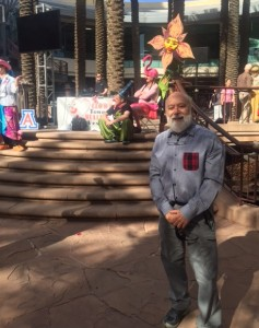Flamingo-headed Dr. Carl Hammerschlag prepares to speak to the crowd in downtown Phoenix at the Clowntown healing festival.
