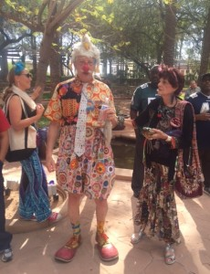 Dr. Patch Adams is in full regalia at the Clowntown healing festival visits with participants at the event.