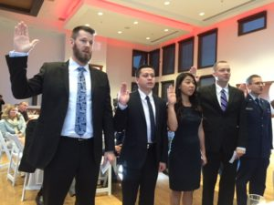 ATSU students taking the oath of service during the military dinner.
