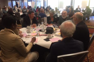 Dr. Jack Dillenberg shares lunch with other presenters at the Sonoma County Oral Health Summit.