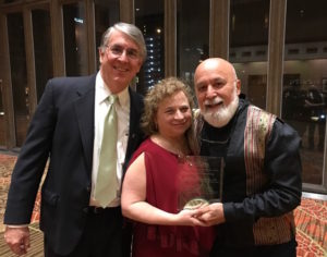 Dr. Jack receives the NNOHA Lifetime Achievement award from the executive director, Phillip Thompson and Dr. Janet Bozzone, President of NNOHA.