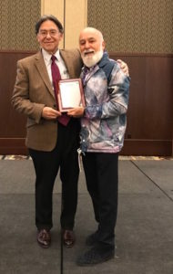 Dr. Jack receives recognition for his career in Public Health Leadership from Dr. Neil Denby.